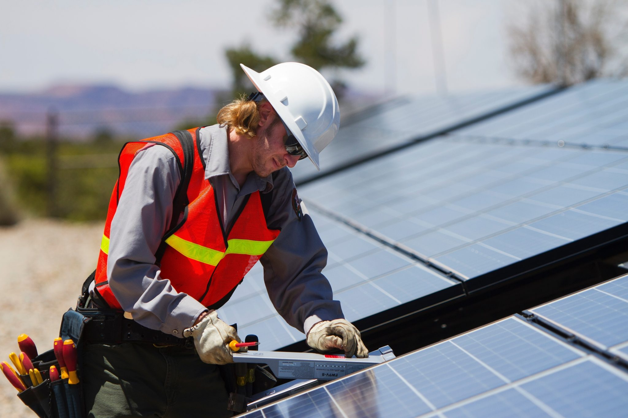 a person installing solar panels