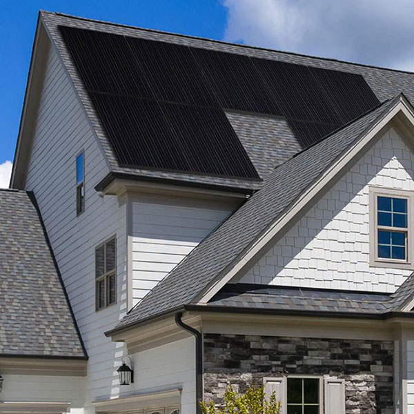 black solar panels on a really slanted roof of a house
