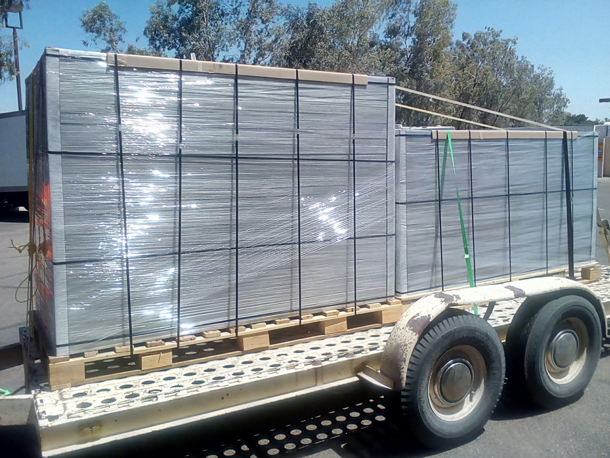 Close up large load of solar panels on trailer