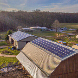 solar panels on top of a barn